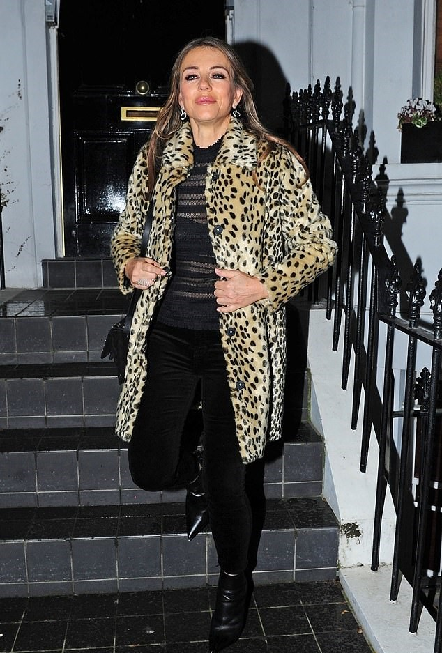 093739e8674 Elizabeth Hurley wearing a sheer black top underneath a leopard print coat  in London SOURCE: The Daily Mail