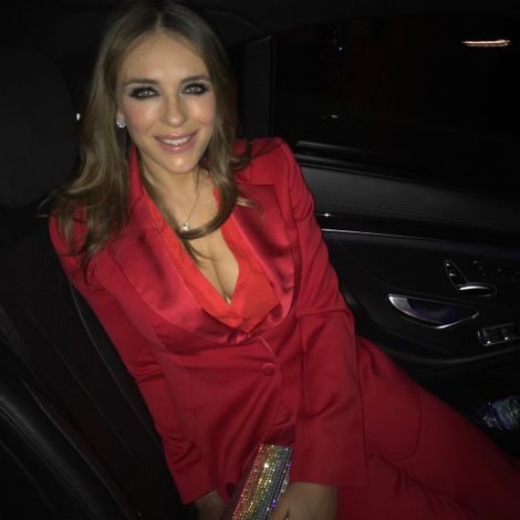 2bbaaac963949 Elizabeth Hurley flaunts her cleavage in a red tuxedo outfit. SOURCE: Elizabeth  Hurley Instagram
