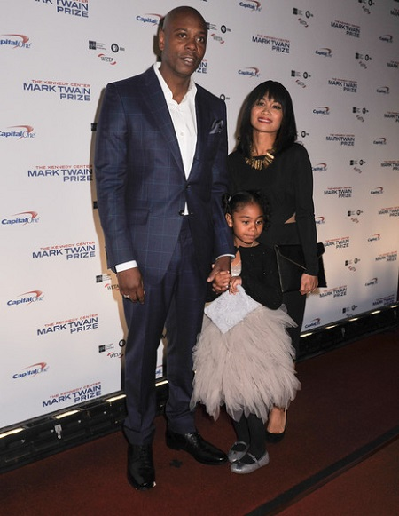 Actress and comedian Dave Chappelle with wife Elaine Chappelle and daughter Sonal Chappelle pose on the red carpet during the 18th Annual Mark Twain Prize For Humor honoring Eddie Murphy at The John F. Kennedy Center for Performing Arts on October 18, 2015 in Washington, DC.