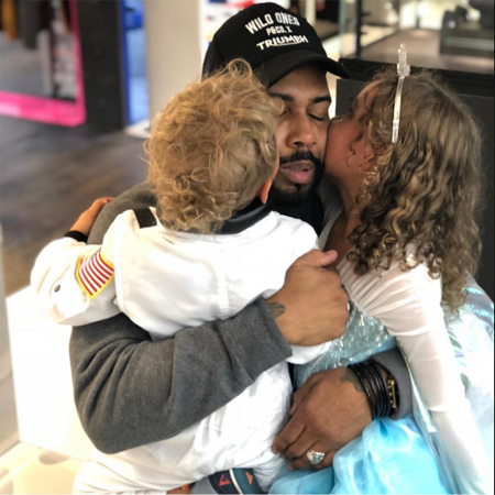 Omari Hardwick with his son and daughter.