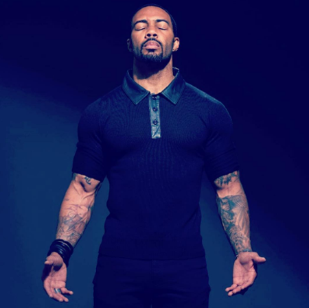 Omari Hardwick with his eyes closed.