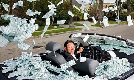Jordan Belfort in a car with photshopped money floating around