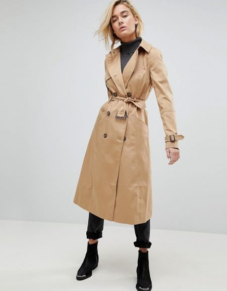 Classic trench coat comes with adjustable belt.