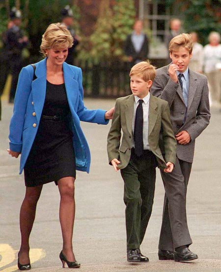 Young Prince Harry and Phillip with their mother.