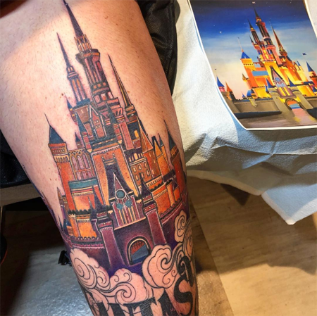 Cinderella Castle on his left thigh.