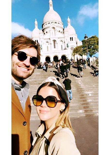 Maren Morris clicking the selfie with Ryan in front of a chapel in Paris, France.