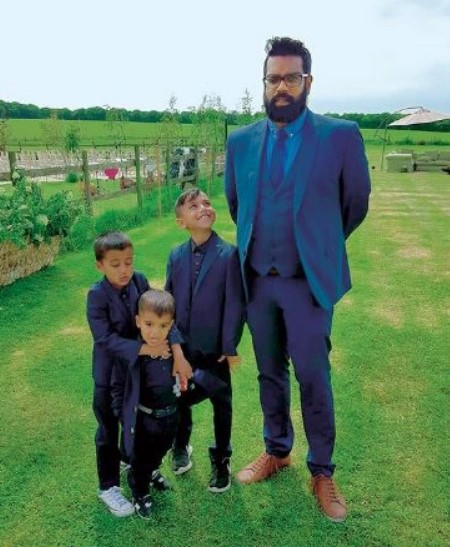 Romesh with three sons
