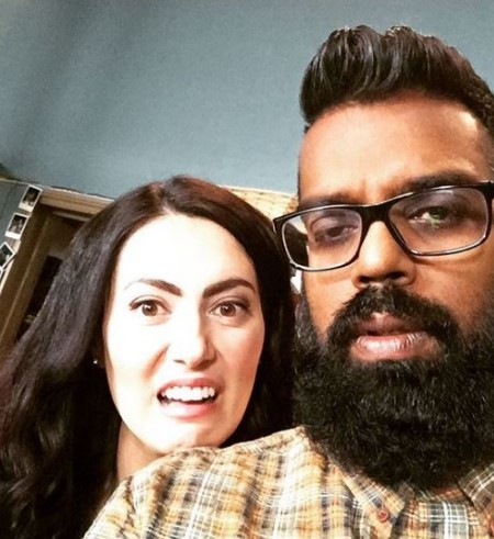 Romesh and Leesa making weird faces for the camera.