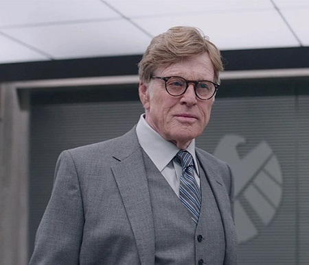 Redford as 'Alexander Pierce' on 'Avengers: Endgame'. Wearing glasses and a grey suit.
