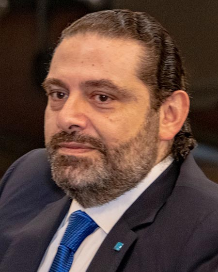 Saad Hariri looking off camera while wearing a suit.