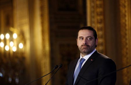 Saad Hariri takes questions during a press conference.