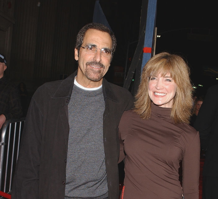 Tony Thomas and Crystal Bernard at a red carpet event.