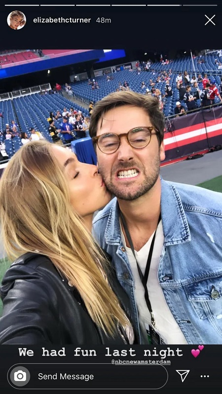 Liz clicking the selfie while kissing Ryan on the cheek as he is making a funny face by cringing his teeth and glasses on.