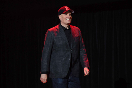 Kevin Feige walking on stage.