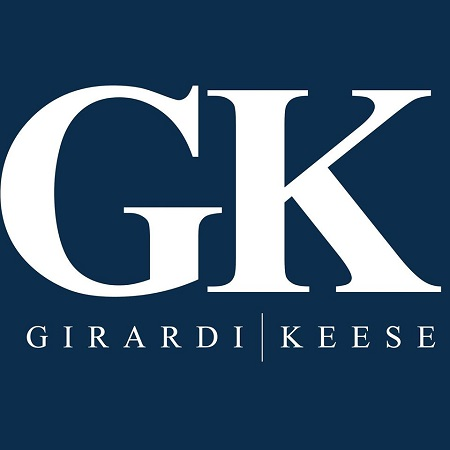 Logo of Girardi | Keese in a blue background.