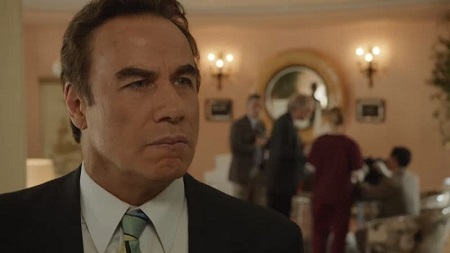 John Travolta looking serious on the show 'American' Crime Story'.