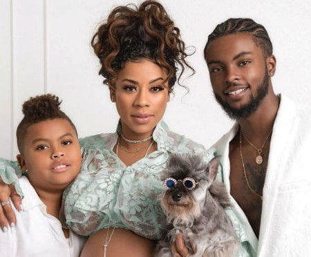 Niko and Keshia with their son, and dog.