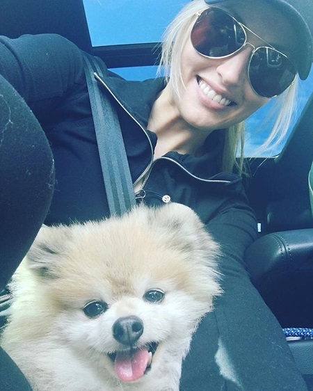 Liz Dueweke taking a selfie with her older dog Wolfie in a car.