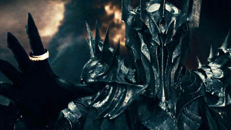 Sauron wearing the all powerful ring in the Lord of the Rings movies.