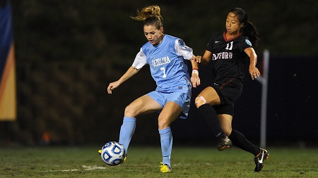 Kealia with the ball against an opponent player when playing for Tar Heels.