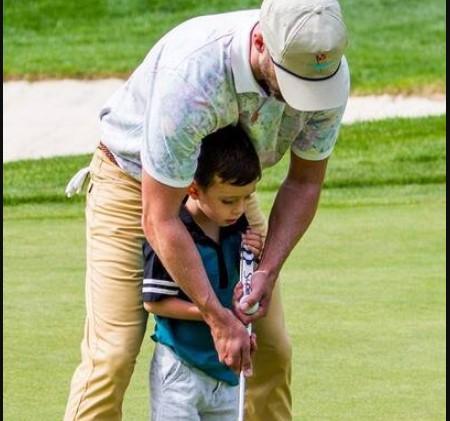 Timberlake golfing with his son.