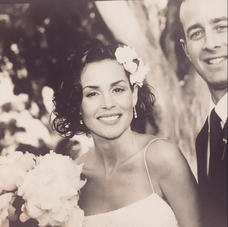 Embeth Davidtz and her husband Jason Sloane during their marriage ceremony.