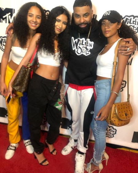 Ginuwine with his three daughters