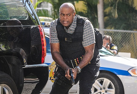 Chi McBride in 'Hawaii Five-0' during a sting operation  with bullet-proof vest and gun.