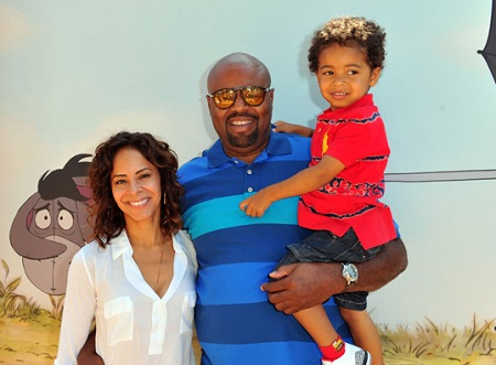Chi Mcbride with his wife Julissa McBride and a son in his left hand.