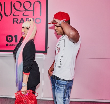 Nicki Minaj and Kenneth Petty heading into the Queen Radio studio. His net worth is not even a million dollars.