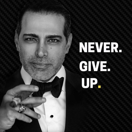 Manny Khoshbin, with a net worth of $50 million, holding a cigar with 'Never Give Up' written beside his headshot in a suit.