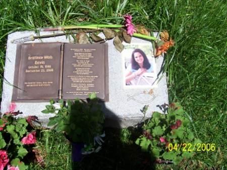 Snap of the cemetery memorial for Brittinay with her photo beside the stone inscription.