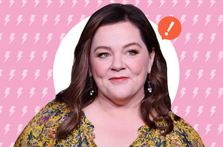 Melissa McCarthy smiling with an exclamation mark to her left.
