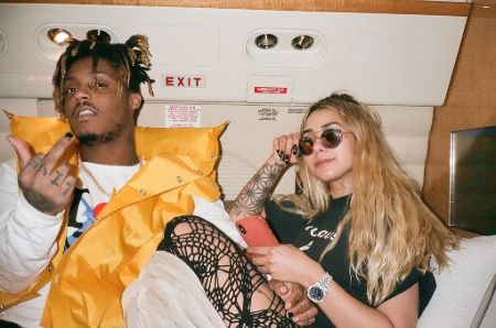 Juice Wrld with girlfriend Ally lotti on a jet, juice holding his middle finger up lotti posing with her diamond studded rolex