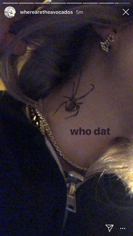 "billie eilish instagram story showing her neck with a temporary tattoo of a spider captioned ""who dat"""