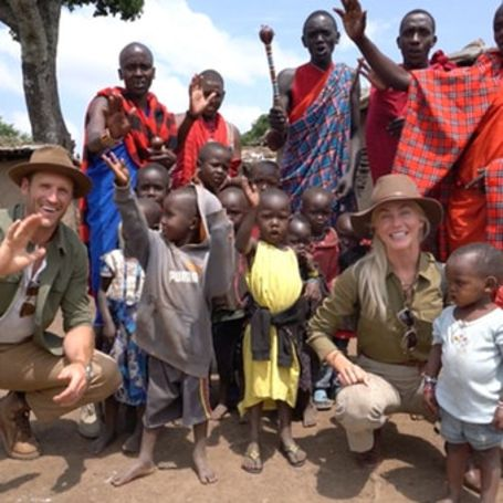 brooks and julianne in africa with african children and women