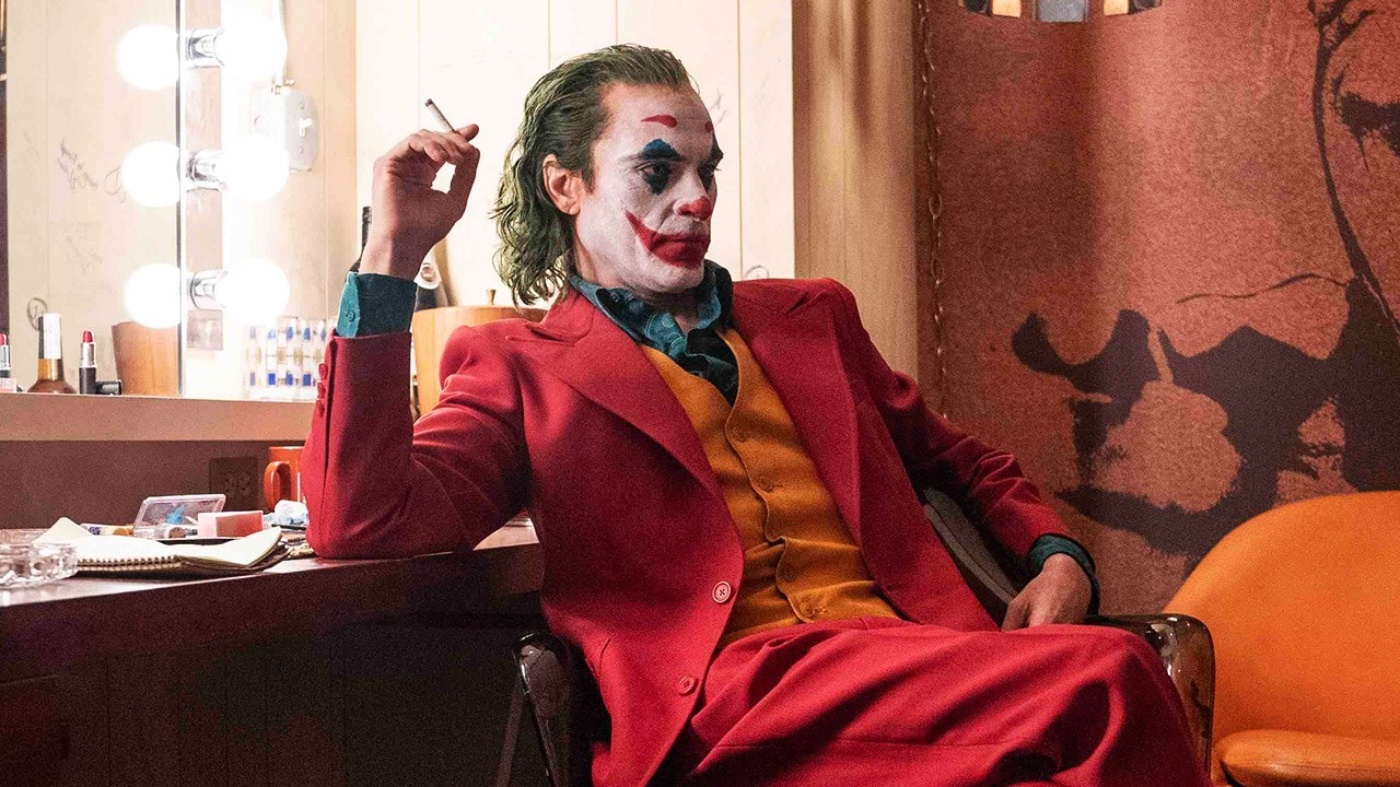 joker in red suit with cigarette in his hand