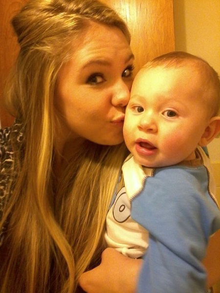 Kailyn Lowry Kissing her son Isaac as he looks at the camera in surprise.