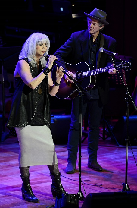 Emmylou Harris and ex-husband Paul Kinnerly on stage during a performance.