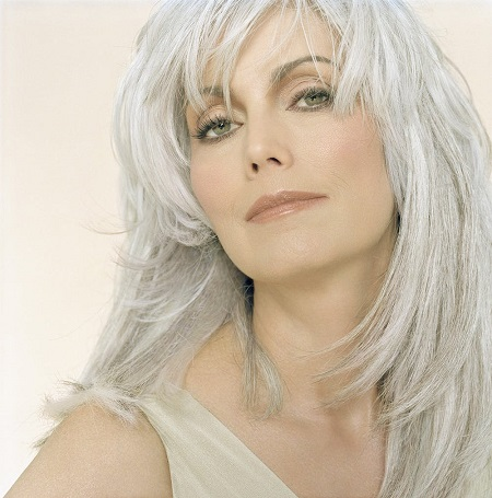 Emmylou Harris Portrait photo with silver hair and background.