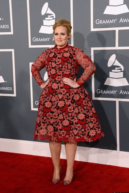 Adele in her floral gown at the 2013 Grammys with her arms in her waist like a princess.