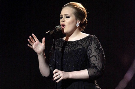 Adele performing on stage during the Brit Awards 2011 at The O2 Arena in London.