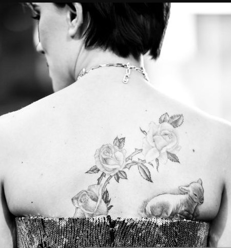 Floral design on the back with a lamb on the shoulder blade of Scarlett Johansson.