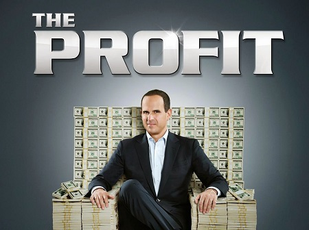 Marcus Lemonis in the poster for 'The Profit' sitting in a throne made of cash.