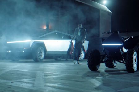 The car-centric video features include extensive shots of Travis using Cybertruck and electric ATV, Cyberquad.
