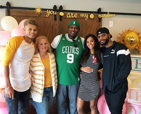 Kendra Bailey and Bryson Tiller with her friends at the baby shower.