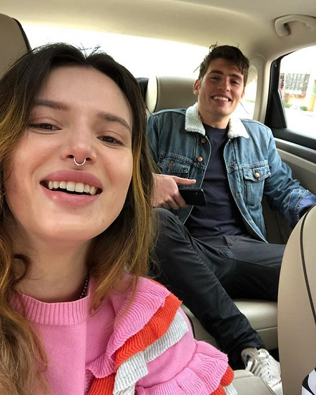 A photo of Bella Thorne (taking a selfie) and Gregg Sulkin from February 2019 inside a car.
