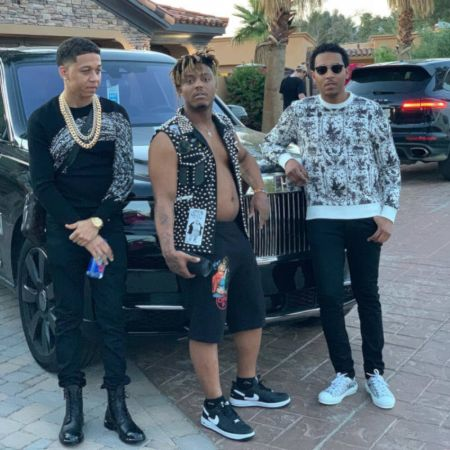 Juice wrld with his 2 friends standing infront of his black Rolls- Royce Cullinan