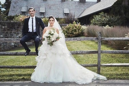 Alaia Baldwin is married to Andrew Aronow. Photo in their wedding dresses.