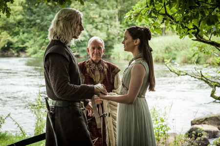 Rhaegar and Lyanna hold hands as a maester marries them in secret b the river.